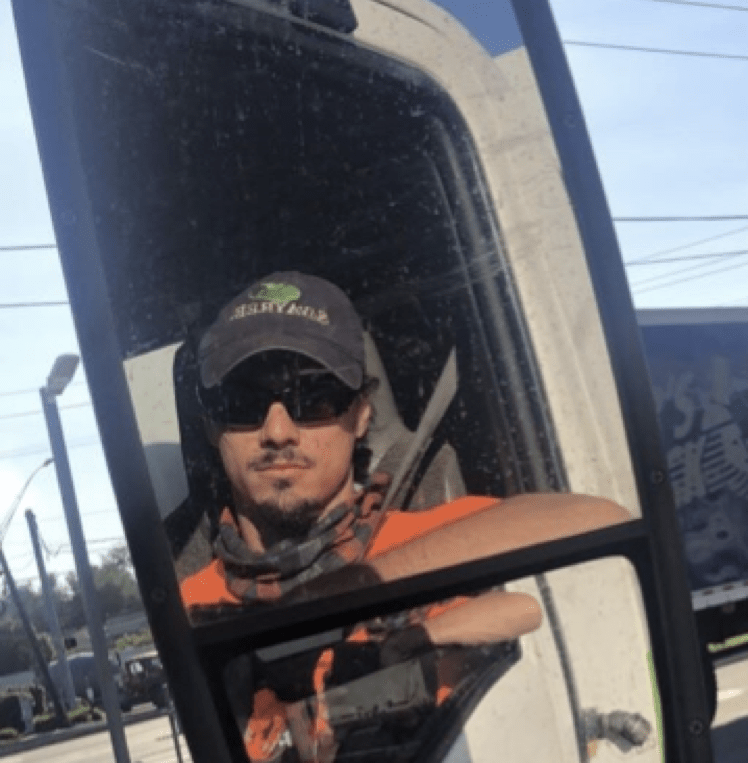 John looking in truck mirror reflection
